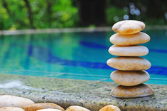 Pebble Stack. Stack of balanced stones near from swimming pool Royalty Free Stock Images