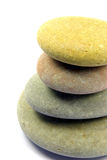 Pebble stack 3. Close-up view on a stack of four pebbles over a white background Royalty Free Stock Image