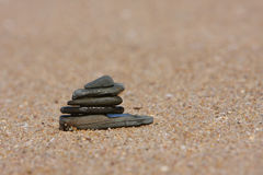Pebble stack on the beach. With a blurred background stock photos
