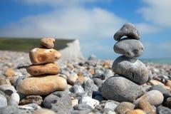 Pebble stack on beach Stock Photos
