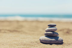 Pebble stack on beach. Closeup photograph of pebble stack with shallow depth of field Stock Images