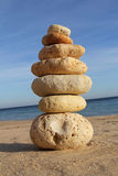 Pebble stack on sandy beach Royalty Free Stock Photography