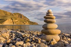 Pebble stack on the sea coast line Royalty Free Stock Image