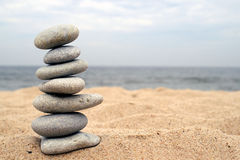Pebble stack on the seashore. Stones balance, pyramid, background , nature Royalty Free Stock Photo