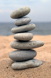 Pebble stack on the seashore. Stones balance, pyramid, background , nature Stock Photos