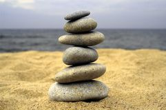 Pebble stack on the seashore royalty free stock images