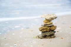 Pebble stack on the seashore Stock Photos