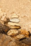 Pebble stack on the seashore. Pyramid of stones on the beach. Light at sunset. Symbol of patience. Concept of harmony and balance. Memory of the sea stock photography