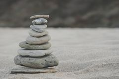 Pebble stack on the seashore. Zen Concept of Concentration and Relaxation. Pebble stack on the seashore. Zen Concept of Concentration and Relaxation Royalty Free Stock Images