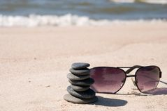 Pebble stack and sunglasse Royalty Free Stock Photos