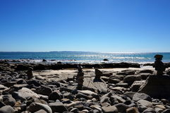 Pebble stacks on the beach, Noosa Royalty Free Stock Photo