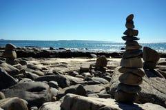 Pebble stacks on the beach, Noosa. Sun, sea and nature in Noosa, Australia royalty free stock photo