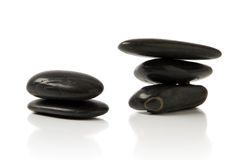 Pebble stone. Black pebble stone over white background Stock Photo