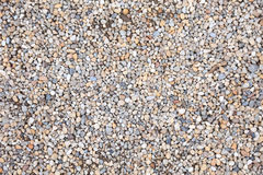 Pebble gravel stone ground floor small pattern smooth texture beach wallpaper rock texture zen background round nature landscape stock photography
