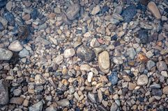 Pebble stone closeup on the shore Royalty Free Stock Photos