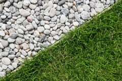 Pebble stone and green grass Royalty Free Stock Images