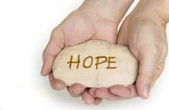Pebble stone in hands. Concept for a hope sign stock photos