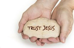 Pebble stone in hands. Concept for a trust jesus sign royalty free stock photography
