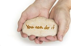 Pebble stone in hands. Concept for you can do it sign. Pebble stone in hands. Concept for you can do it sign stock images
