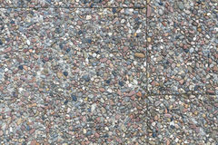 Pebble stone plates in cement on a sideway Royalty Free Stock Photos