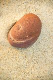 Pebble stone on a beach. Pebble stone on a sandy beach stock image