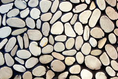 Pebble stone wall. As background Stock Photos