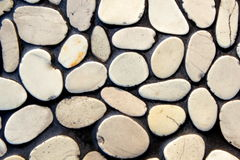 Pebble stone wall. As background, close up Royalty Free Stock Photos