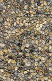 A pebble stone wall made of natural stones Royalty Free Stock Images