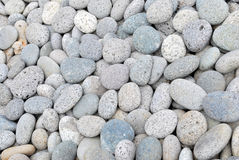 Pebble stones background. A background of gray pebble stones Royalty Free Stock Photos