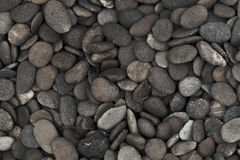 Pebble  stones for background. Macro shot. Top view. Royalty Free Stock Photography