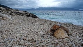 Pebble stones beach and blue sea stock video footage
