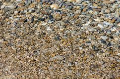 Pebble stones into the clean water. Light and bright pebble stones into the clean water Royalty Free Stock Photo