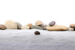 Pebble stones on gray sand. Composition with pebble stones on gray sand Royalty Free Stock Images
