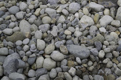 Pebble stones. Lake color pebble stones background Royalty Free Stock Images