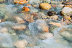 Pebble stones in the river water close up view Stock Photos