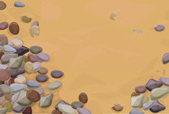 Pebble stones on sand Stock Images