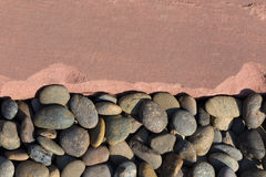 Pebble stones and sand stone background Stock Image