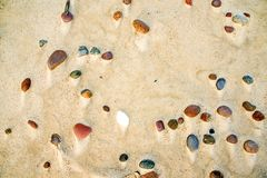 Pebble stones on a beach. Pebble stones on a sandy beach Royalty Free Stock Photos