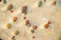 Pebble stones on a beach. Pebble stones on a sandy beach Stock Photo