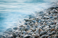 Pebble stones by the sea Stock Photo