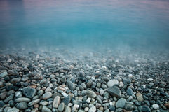 Pebble stones by the sea Royalty Free Stock Image
