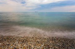 Pebble stones by the sea Stock Photography