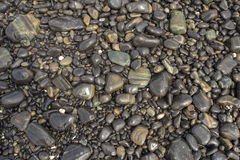Pebble stones by the sea Stock Photos
