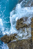 Pebble stones by the sea. Silky waves of blue sea Royalty Free Stock Photos