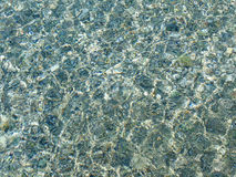 Pebble stones in the sea water Royalty Free Stock Images