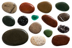 Pebble stones. Set of beautiful sleek pebble stones, close up on white background stock photography