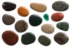 Pebble stones. Set of beautiful sleek pebble stones, close up on white background stock image