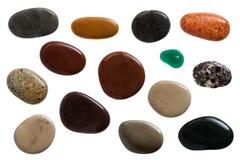 Pebble stones. Set of beautiful sleek pebble stones, close up on white background royalty free stock photos