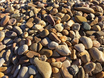 Pebble stones. Smooth pebble stones, building material Stock Images