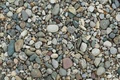 Pebble stones on the surface. Pebble stones on an area Stock Photo